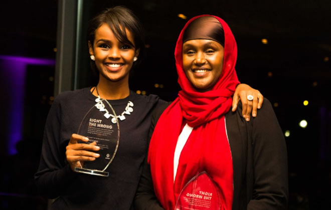 """Ilwad Elman and her mother, Fartuun Adan, accept an Oxfam Right the Wrong award. """"We believe everyone's life is important,"""" says Adan. Photo Credit: Keith Lane/ Oxfam America"""