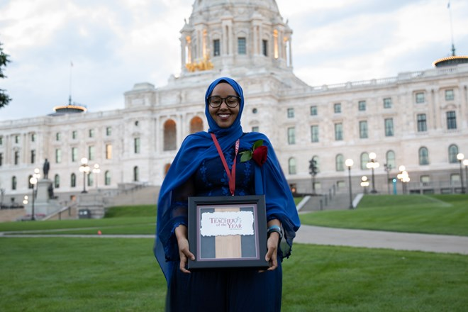 Qorsho Hassan, Minnesota's 2020 Teacher of the Year, holds her makeshift award in front of the state Capitol Thursday night. The frame will be replaced with an engraved plaque. Credit: Jaida Grey Eagle | Sahan Journal