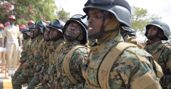 Somali National Army soldiers march during the 57th Anniversary of the Somali National Army held at the Ministry of defence in Mogadishu on April 12, 2017. Image: Ilyas Ahmed/AMISOM