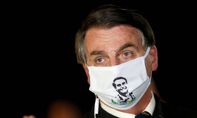 Bolsonaro in late May. The president has flouted social distancing and attended events and political rallies. Photograph: Adriano Machado/Reuters