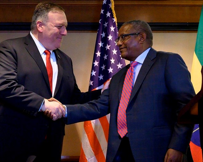 In this Tuesday, Feb. 18, 2020 file photo, U.S. Secretary of State Mike Pompeo, left, shakes hands with Ethiopia's Foreign Minister Gedu Andargachew, during a joint press conference at the Sheraton Hotel, in Addis Ababa, Ethiopia. In an interview with The Associated Press Friday, June 19, 2020, Ethiopia's Foreign Minister Gedu Andargachew declared that his country will go ahead and start filling the $4.6 billion Grand Ethiopian Renaissance Dam next month, even without an agreement with Egypt and Sudan.  POOL PHOTO VIA AP, FILE / ANDREW CABALLERO-REYNOLDS