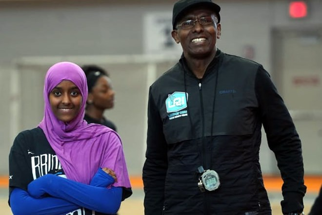 Abdi Bile, right, worked over the summer with Ayan Yusuf,18. Ayan had plans to run for Minneapolis South High School.RICHARD TSONG-TAATARII – MINNEAPOLIS STAR TRIBUNE