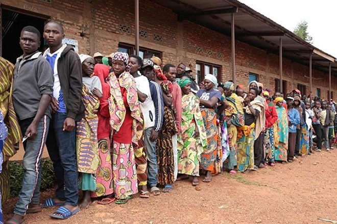 Burundians wait in a line to vote during the general elections at a polling station in Bubu Primary School in Giheta, central Burundi, on May 20, 2020. PHOTO | AFP