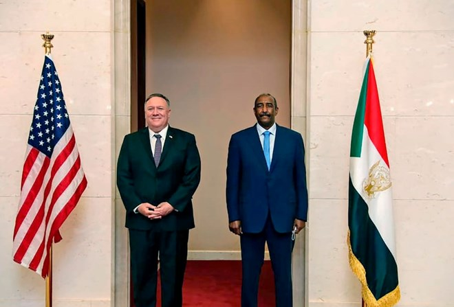 Secretary of State Mike Pompeo with Lt. Gen. Abdel Fattah al-Burhan, the head of Sudan's military council, in Khartoum on Aug. 25. (Sudanese cabinet/AP)
