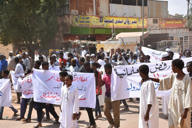 Demonstrators in the Sudanese capital of Khartoum last week protest a deal the United Arab Emirates and Bahrain agreed to with Israel to normalize relations. (Abbas M. Idris/Anadolu Agency/Getty Images)