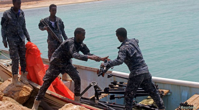 Somali Puntland forces receive weapons seized in a boat on the shores of the Gulf of Aden in the city of Bosasso, Puntland region, Somalia September 23, 2017.