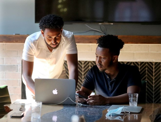 Entrepreneurs Salman Elmi, left, and Abdi Hassan are co-founders of Top Figure. — David Joles, Star Tribune