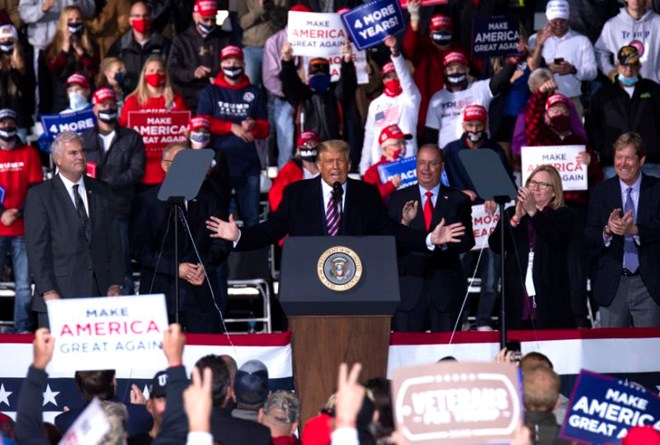 """President Donald Trump's remarks at a campaign rally in Bemidji on Friday, Sept. 18, included both negative references to refugees and praise for the """"good genes"""" of his almost all-white audience.(Stephen Maturen/Getty Images)"""