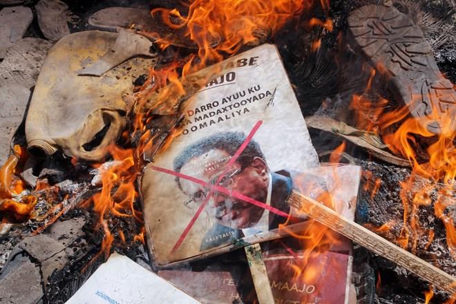 Demonstrators burned photographs of President Mohamed Abdullahi Mohamed in Mogadishu.Credit...Farah Abdi Warsameh/Associated Press