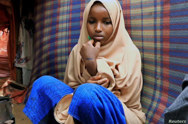 Nurta Mohamed, 13, a Somali girl sits inside her mother's makeshift shelter after she ran away from a suspected forced marriage at the Alafuuto camp for internally displaced persons in Garasbaaley district of Mogadishu, Somalia on Aug. 14, 2020.