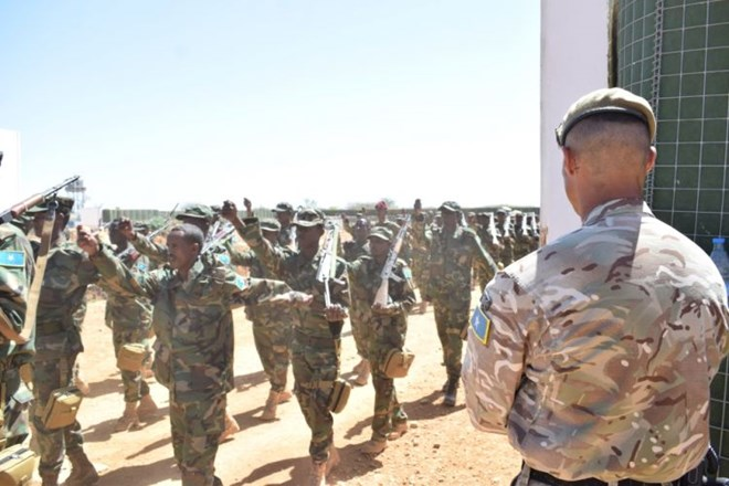 Soldiers and officers from 8 Brigade, Somalia National Army marching past a UK instructor during their graduation ceremony in Baidoa, Somalia (Picture: MOD).