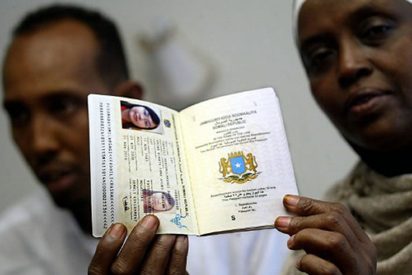 Somalia takes steps to combat forgery business officials from somalias transitional federal government show a copy of the countrys biometric passport in november 2006 the state of the art passport yadclub Image collections