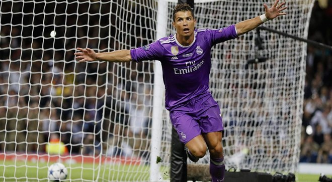 Ronaldo scores 2 to lift Real past Juve in Champions ...