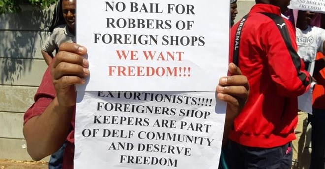 Four accused of extorting 'protection money' from Somali shopkeepers denied bail