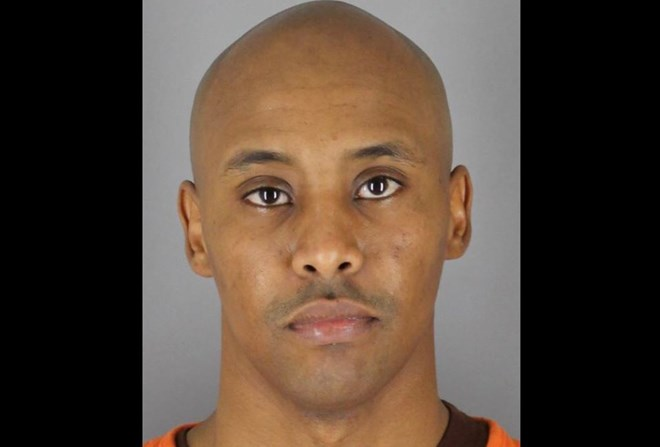 Minneapolis police officer Mohamed Noor turns himself in on murder, manslaughter charges in Justine Damond killing