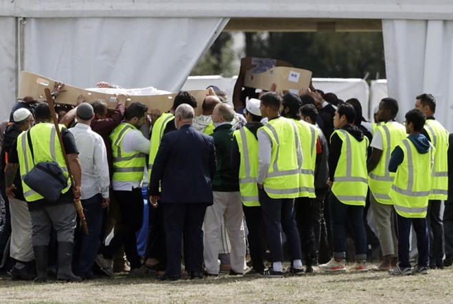 Burials begin for New Zealand mosque shooting victims, PM visits school