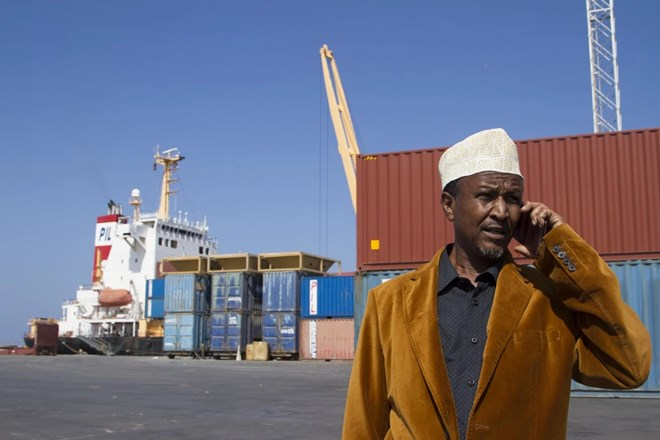 Port manager Ali Omer speaks on the phone at Berbera port in the Somaliland autonomous region of Somalia. (Paul Schemm/For The Washington Post)