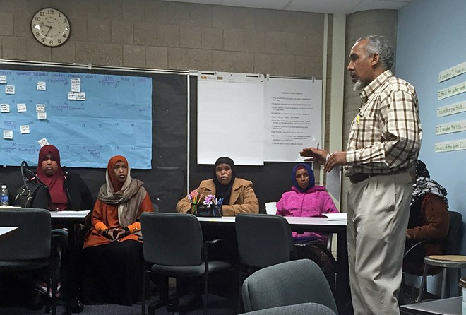 Mohamed Abass translates for newly immigrated Somali parents during the Waalidow Indhaha Furr session at Andersen United Community School on Dec. 2, 2015 in Minneapolis. Vanessa Nyarko