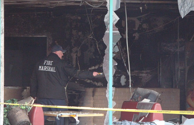 Investigators could be seen taking pictures of the site and digging through debris at Juba Coffee House, where a fire broke out in the early hours of Tuesday morning. Grand Forks Herald photo by Lori Weber Menke