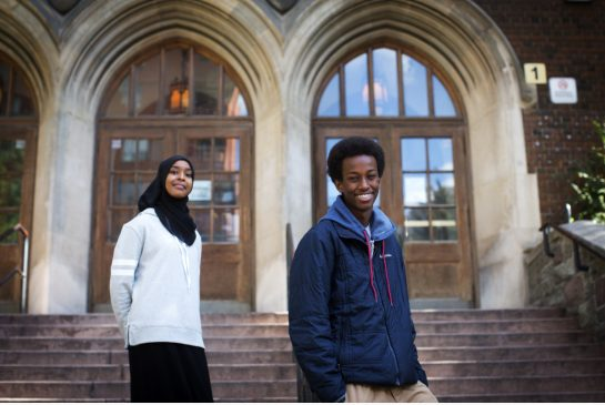Grade 11 students Amal Absiye, left, and Hamza Bashir at Jarvis Collegiate. Grad rates among Somali students are going up thanks to special programs addressing past achievement gaps.