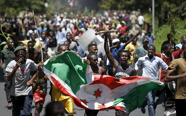 May 2015: Protesters carry a Burundi flag during a protest against President Pierre Nkurunziza's decision to run for a third term in Bujumbura, Burundi   Photo: Reuters