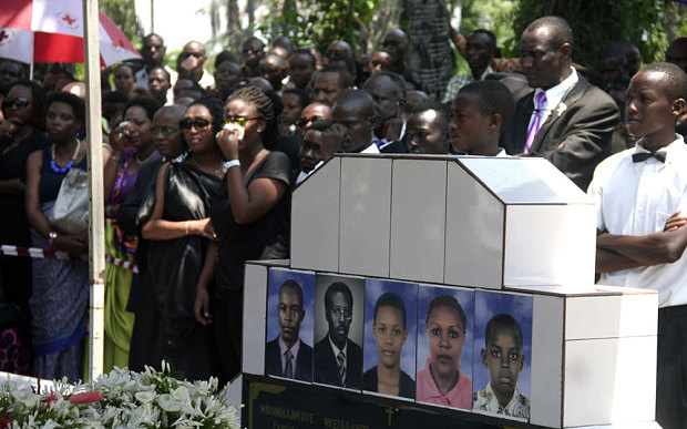 People attend the funeral of a Burundian journalist and his family and a member of the International Organization for Migration (IOM) humanitarian team in Bujumbura after they were shot dead on October 13.  Photo: AFP