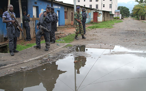Burundian police and soldiers guard a deserted street in Bujumbura  Photo: AP