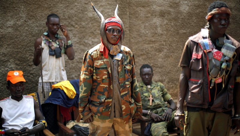 Anti-Balaka Christian militiamen stand in the Combatant district of Bangui, Central African Republic, Tuesday Feb. 4, 2014.