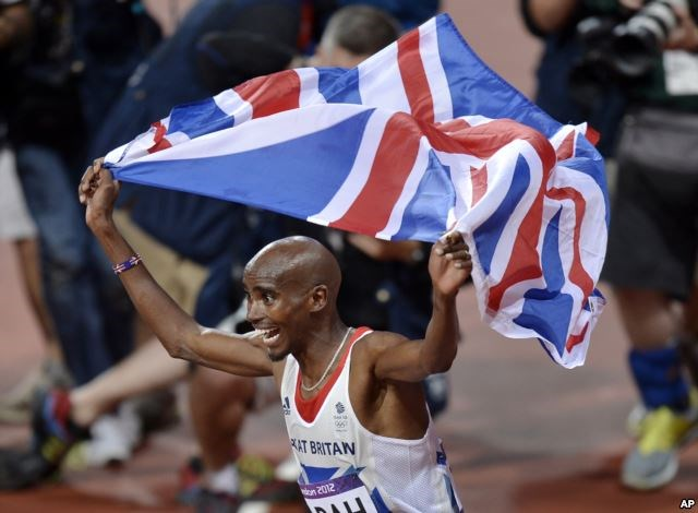 FILE - Britain's Mo Farah celebrates winning gold in the men's 10,000-meter final at Olympic Stadium at the 2012 Summer Olympics, London, Aug. 4, 2012. Farah moved to Britain as a child from his native Somalia.