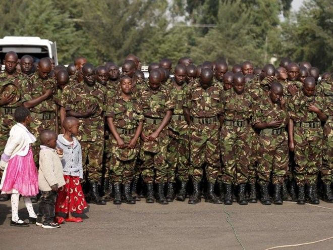 Children watch as members of the Kenya Defence Forces attend prayers to pay respects to the Kenyan soldiers serving in the African Union Mission in Somalia (AMISOM), who were killed in El Adde during an attack, at a memorial mass at the Moi Barracks in Eldoret, January 27, 2016. Photo/REUTERS