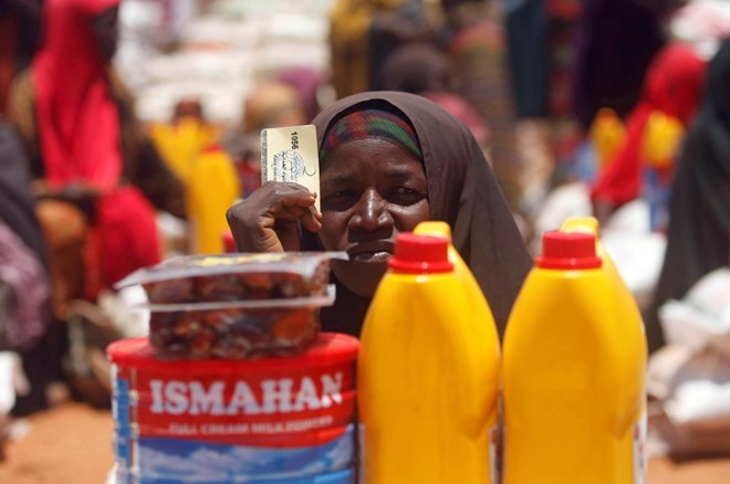 An internally displaced Somali woman receives basic food supplies at a distribution center organized by a Qatar charity in Baidoa on April 9. Photo by Feisal Omar/Reuters
