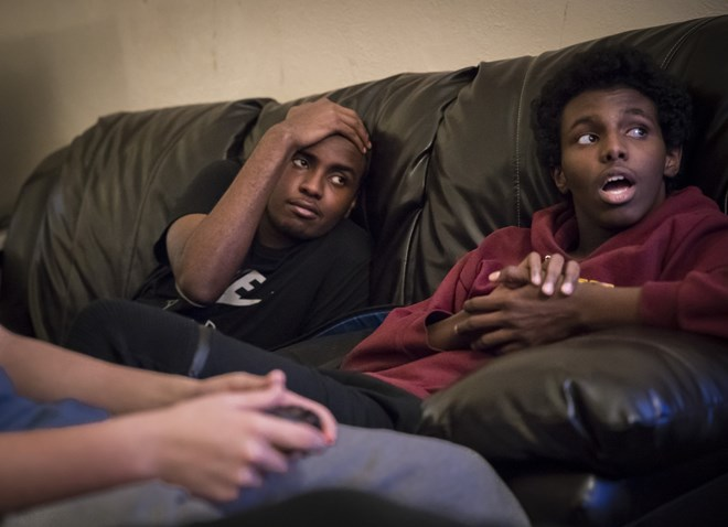 Mohamed Hassan hung out with his brother Ali Hassan watching friends play video games at an after school game tournament at Roosevelt High School on December 2, 2016. Renee Jones Schneider