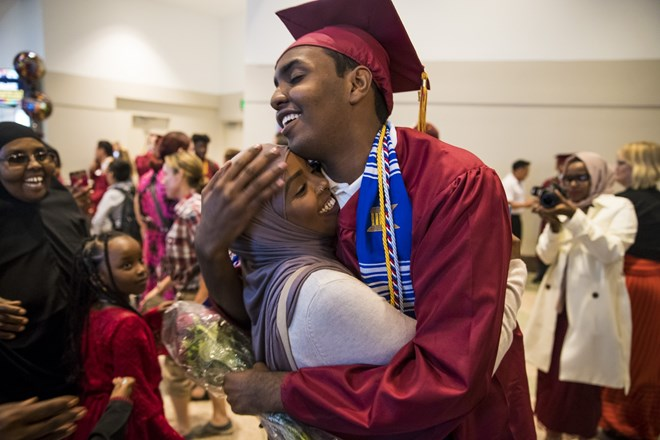 Mohamed Hassan hugged his older sister Ifrah Hassan as he was surrounded by family members after his graduation ceremony on June 8, 2017 at the Minneapolis Convention Center in Minneapolis, Minn. Renee Jones Schneider