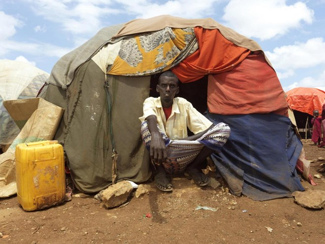 Hussein Ali Isaak, 40, Dusta IDP camp. Hussein lives with his wife and five children, Hussein took out a loan from neighbours to take his family to the camp, to pay food and medicines for his children. He lost his sixth son, Mohamed, to cholera in the cam