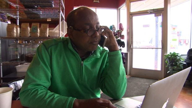 Omar Jamal, who is executive director of the Somali Community of Minnesota, often fields calls from people who are trying to sneak into Canada. (Karen Pauls/CBC)