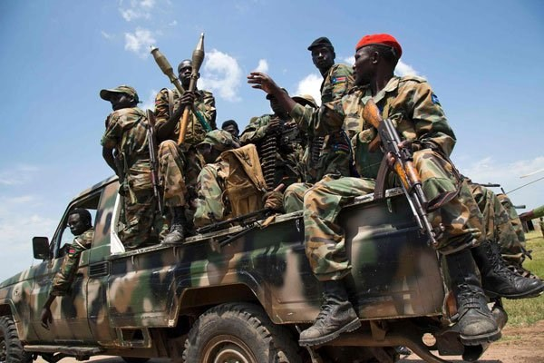 Soldiers of the Sudan People Liberation Army sit in a pick-up truck at the military base in Malakal, northern South Sudan, on October 16, 2016. FILE PHOTO | ALBERT GONZALEZ FARRAN | AFP
