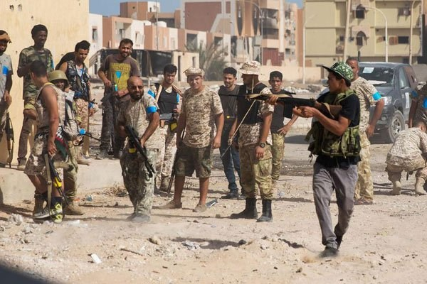 Fighters of the forces loyal to Libya's UN-backed Government of National Accord (GNA) hold a position in the coastal city of Sirte on October 27, 2016. The Libyan capital has been controlled by dozens of militias. PHOTO | AFP