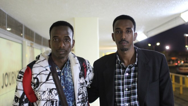 Abdi Nor (L) and his older brother Hassan Iftin (R) wish each other well at Nairobi Airport,  Aug. 11, 2014. A few minutes after this photo was taken, Abdi boarded a flight to start a new life as a green card holder in Boston. The brothers have not been able to meet since.