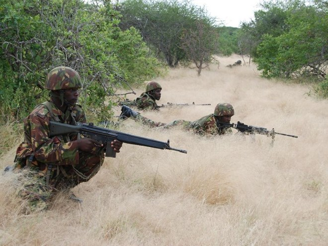A file photo of KDF soldiers taking cover during an operation in Somalia. /FILE