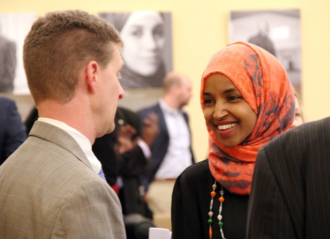 Shep Harris, left, a lobbyist hired by the Coalition of Somali American Leaders, speaks with Rep. Ilhan Omar in St. Paul, Minn., on Jan. 22, 2016. Laura Yuen | MPR News
