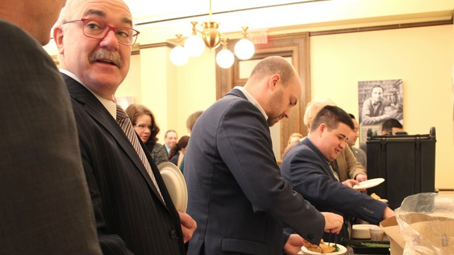 State lawmakers and staff, including Sen. David Tomassoni, second from left, line up for sambusas at the Capitol on Jan. 22, 2017. Laura Yuen | MPR News