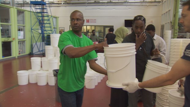 Local volunteers and members of the Canadian Somali community packed family emergency kits for African countries ravaged by severe drought conditions. (CBC)