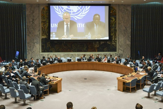A wide view of the Security Council Chamber as Michael Keating (left on screen), Special Representative of the Secretary-General and Head of the UN Assistance Mission in Somalia (UNSOM), briefs the Council via video link. UN Photo/Eskinder Debebe