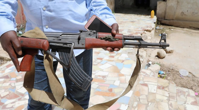 A Somali Dealer holds a weapon looted from a former United Arab Emirates (UAE) military training camp during a Reuters interview in Mogadishu, Somalia April 25, 2018. Reuters/Feisal Omar