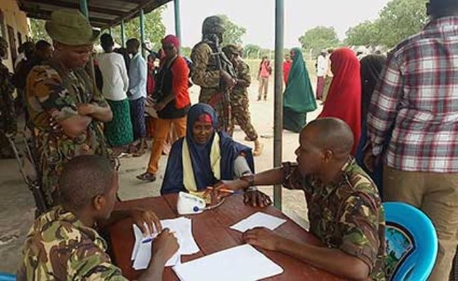 KDF medical personnel treat residents of Kotile which is within the Linda Boni operation zone. Most hospitals in the area have been closed down due to persistent Al-Shabaab attacks. PHOTO | KALUME KAZUNGU | NATION MEDIA GROUP