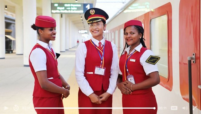 Saliha Muhammed, intern-captain of Addis Ababa-Djibouti Railway, greets passengers before the train departs./CGTN Photo