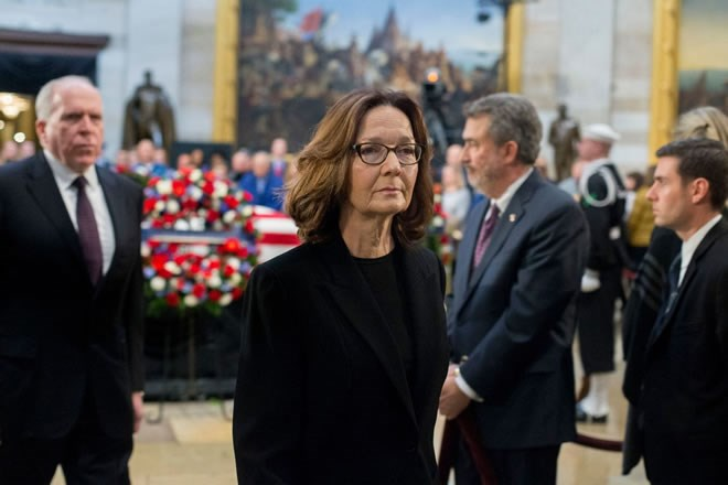 CIA Director Gina Haspel visits the casket containing former president George H.W. Bush's remains at the U.S. Capitol on Dec. 4. (Michael Reynolds/EPA-EFE/Shutterstock)
