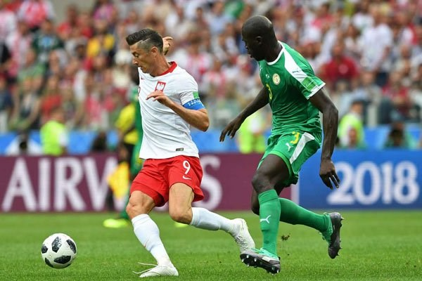 Poland's forward Robert Lewandowski (left) vies with Senegal's defender Kalidou Koulibaly during their 2018 World Cup Group H match at the Spartak Stadium in Moscow on June 19, 2018. PHOTO | FRANCISCO LEONG | AFP