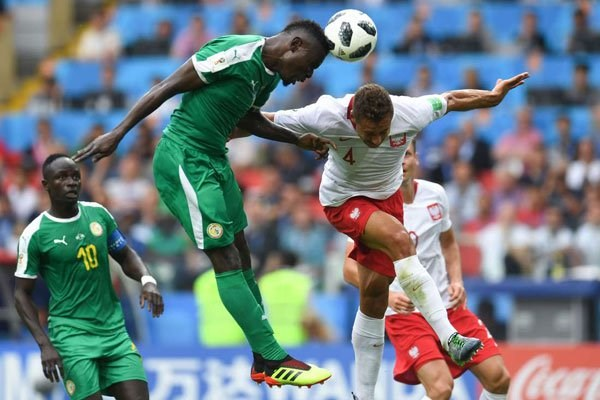 Senegal's midfielder Alfred N'Diaye (left) vies with Poland's defender Thiago Rangel Cionek during their 2018 World Cup Group H match at the Spartak Stadium in Moscow on June 19, 2018. PHOTO | PATRIK STOLLARZ | AFPAFP
