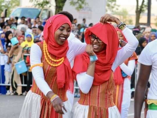 """The young men and women of the Somali Museum Dance Troupe study and perform traditional dances from all regions of Somalia. The dancers are high school and college students passionate about sharing their culture. They perform throughout the United States. The """"Somalis + Minnesota"""" exhibit opens June 23, 2018 at the Minnesota History Center. (Photo: Mustafa Ali)"""